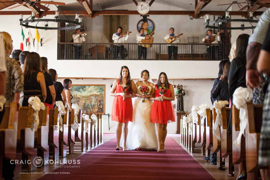 escorting down aisle with daughters